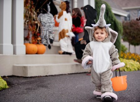 Child in Halloween costume trick or treating